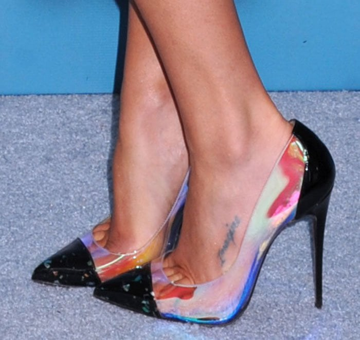 Lea Michele shows off her foot tattoo in Christian Louboutin pumps