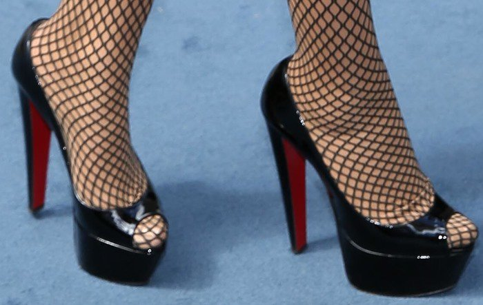 Mariah Carey in fishnet stockings and black Christian Louboutin heels