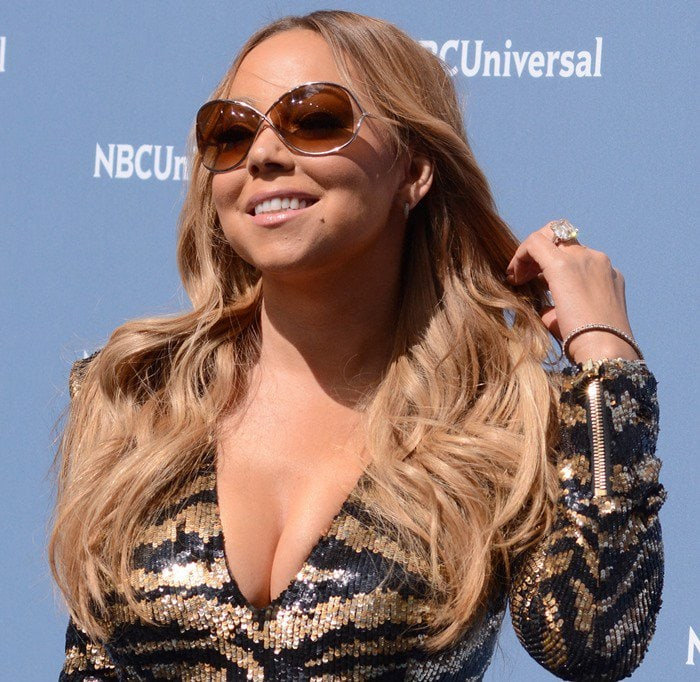 Mariah Carey on the blue carpet in a long-sleeved Balmain tulle mini dress