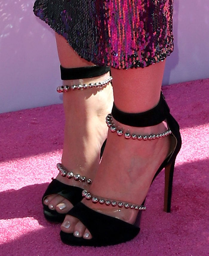 Meghan Trainor shows off her sexy feet inbead-embellished PVC and suede sandals