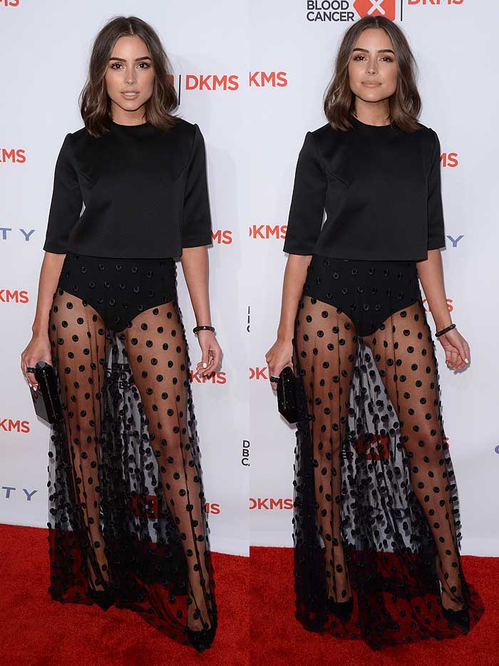 Olivia Culpo kept her decolletage covered in a conservative Camilla and Marc 3/4-sleeve top