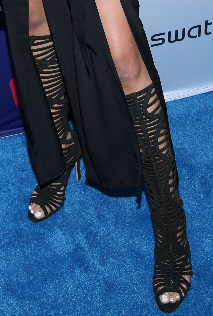 Olivia Culpo shows off her sexy toes in black shoes