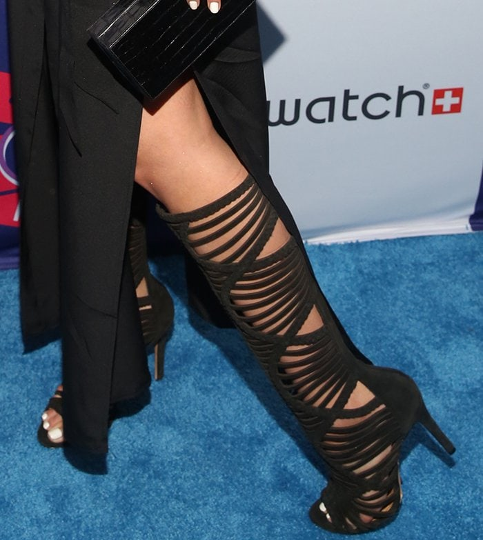 Olivia Culpo in Schutz knee-high cage boots