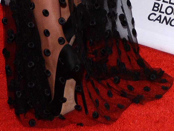 Olivia Culpo in black satin pumps