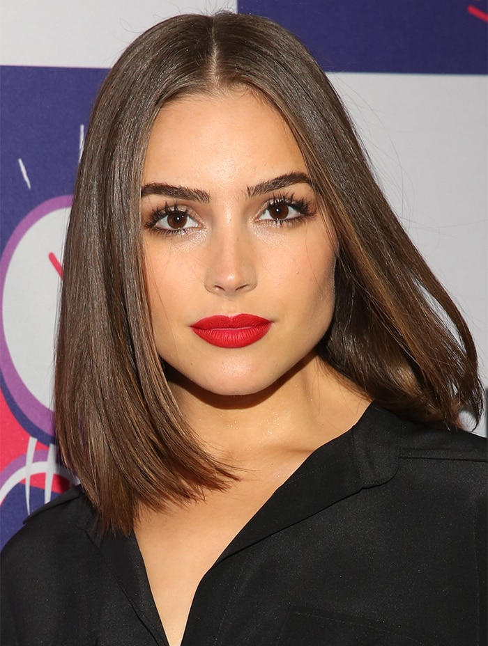Olivia Culpo's red lipstick added a pop of color to the look