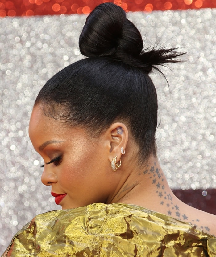 Rihanna showing off her neck and upper back star tattoos that were inked in 2008
