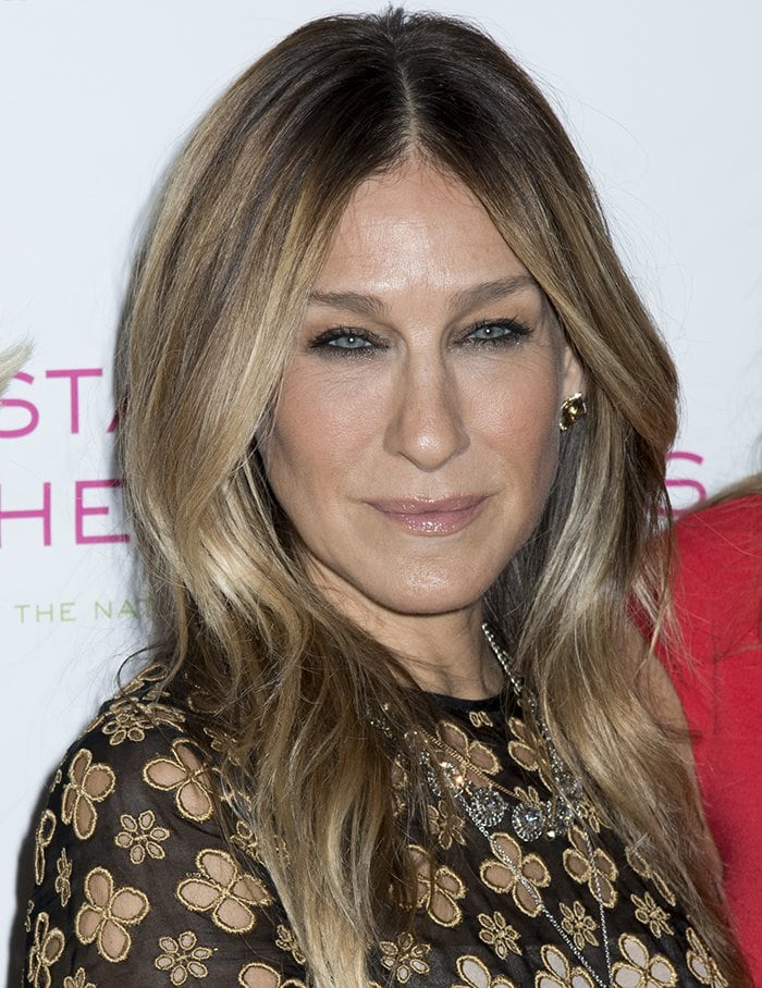 Sarah Jessica Parker's locks were parted down the middle and styled in soft waves