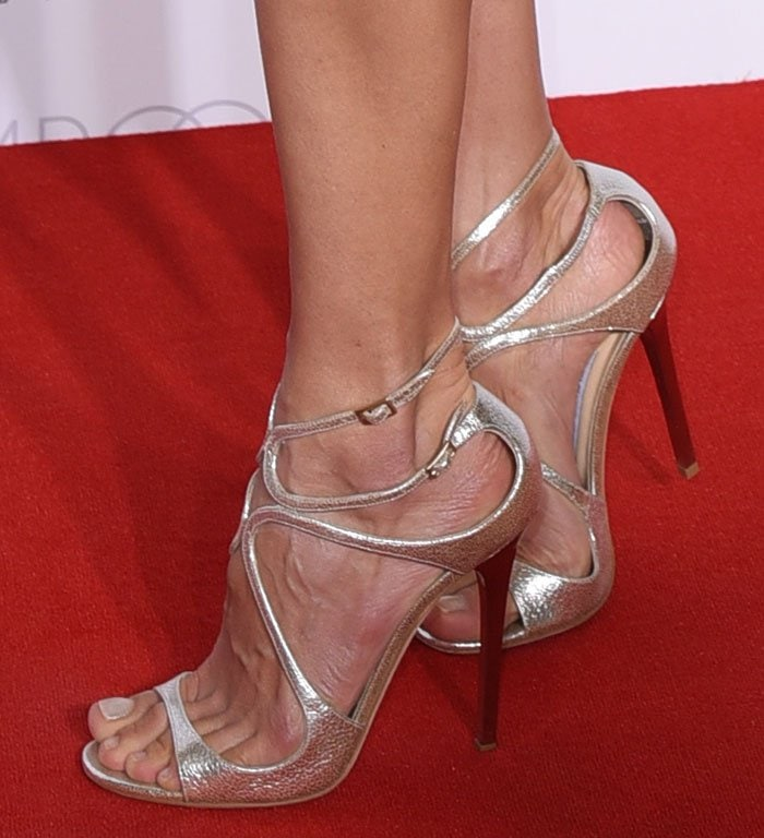 Alessandra Ambrosio shows off her feet in strappy silver sandals