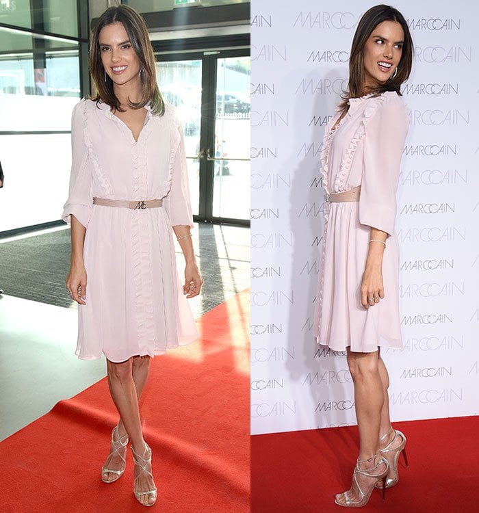Alessandra Ambrosio styled the feminine dress with a belt