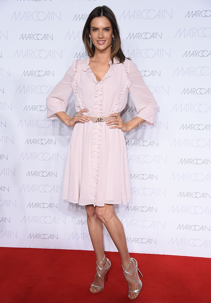 Alessandra Ambrosio flaunts her sexy legs in a pastel pink dress from Marc Cain's collection