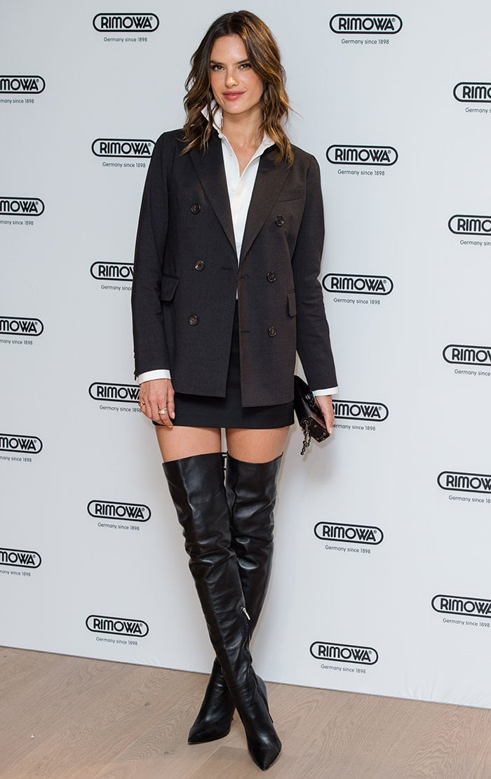 Alessandra Ambrosio made her presence felt as she arrived in a sexy, androgynous DSquared2 ensemble paired with racy thigh-high boots