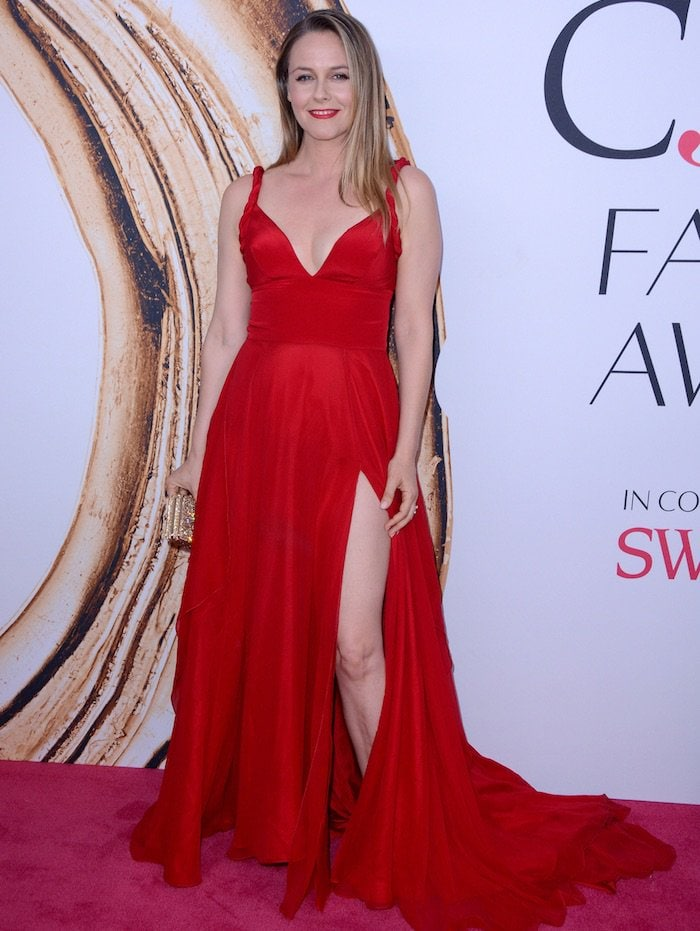 Alicia Silverstone looked lovely in a red silk evening gown with a short v-neckline