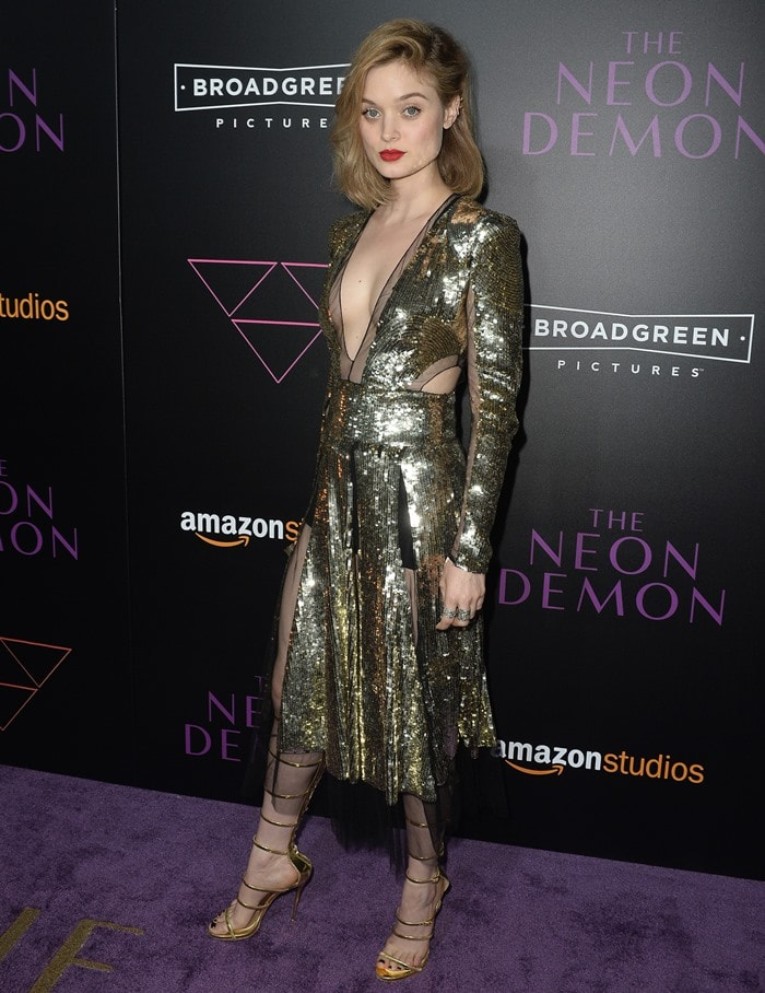 Bella Heathcote's sky-high Giuseppe Zanotti sandals clashed with her sequined Alexander McQueen Pre-Fall 2016 dress that featured cutouts and plunging neckline