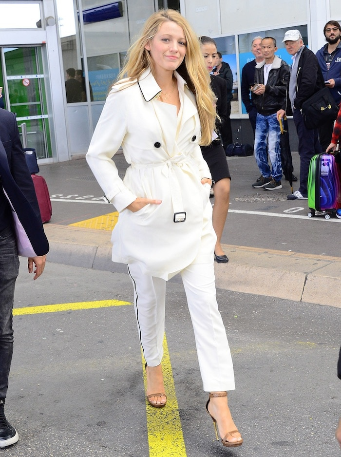 Blake Lively arrived in Cannes, France in an all-white ensemble paired with brown sandals on May 9, 2016