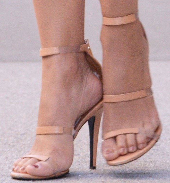 Camila switches out her Giuseppe Zanotti for a pair of the Tamara Mellon 'Frontline' sandals