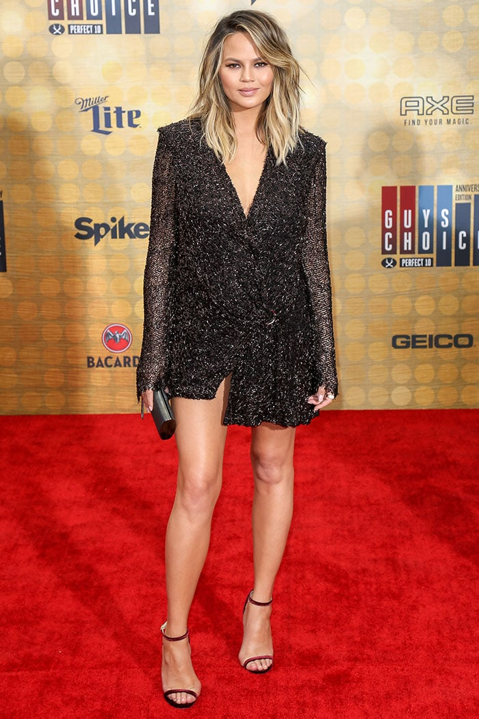 Chrissy Teigen flaunting her toned legs and cleavage on the red carpet