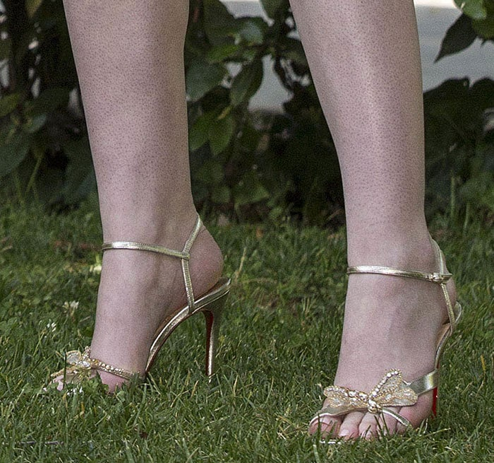 Elle-Fanning-Christian-Louboutin-crystal-embroidered-gold-sandals