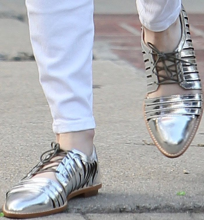 Emma Roberts dresses up a seemingly plain outfit with Loeffler Randall Fay oxfords in silver