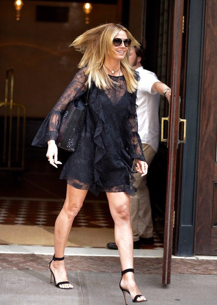 Heidi Klum leaving her hotel in lace dress