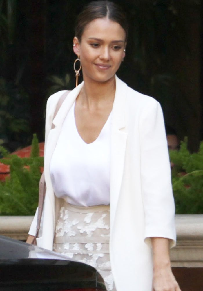 Jessica Alba wore a white top and blazer with a midi lace cutout skirt by Dorothee Schumacher