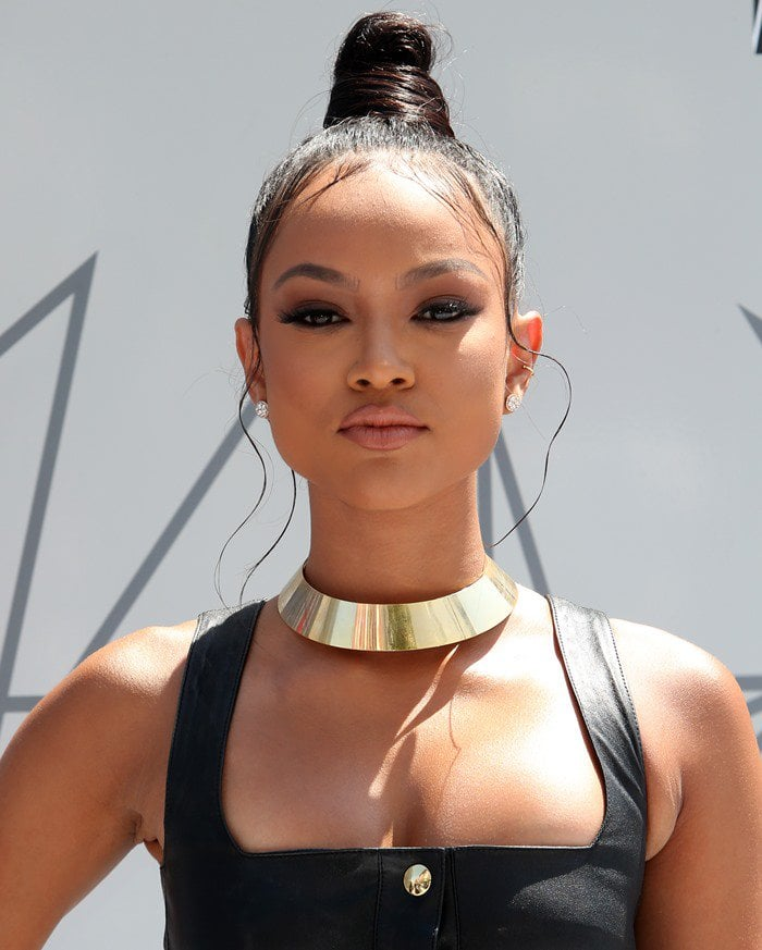 Karrueche Tran came dressed in a skin-tight black leather dress featuring gold buttons down the entire front