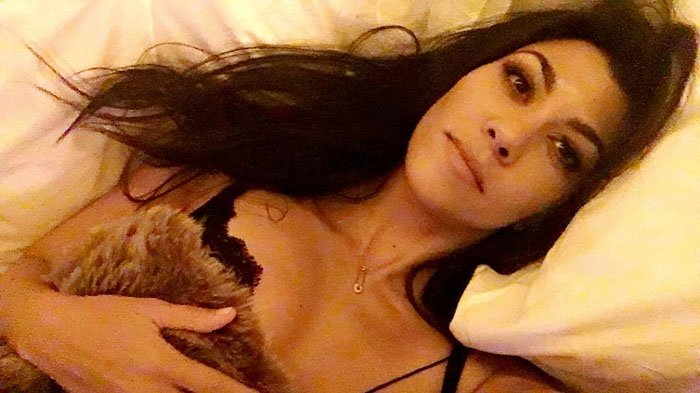 Kourtney Kardashian uploads a morning selfie of her still wearing her lace bra from her night of partying