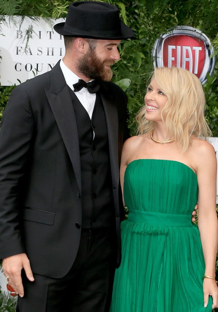 The look of love: Kylie poses with her fiancé on the red carpet