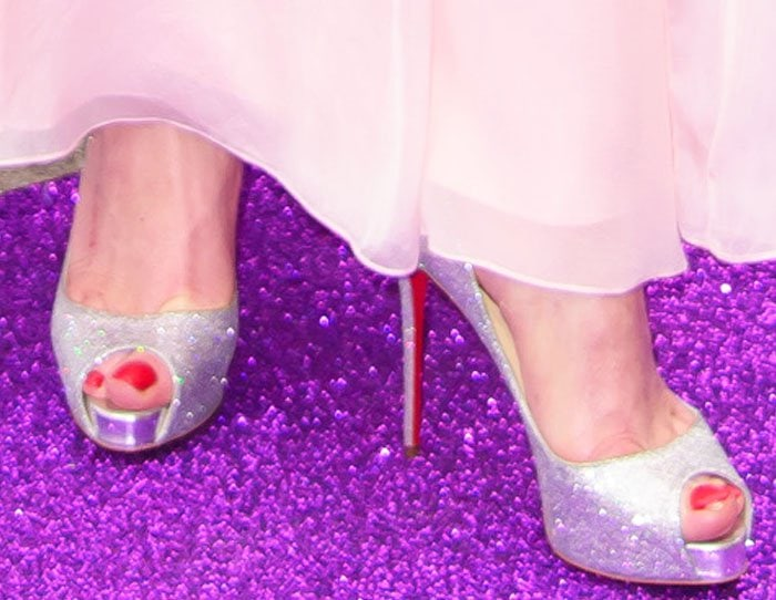 Lindsay Lohan shows off her toes in New Very Riche pumps