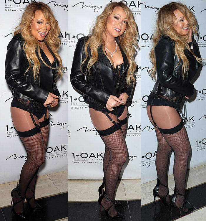 Mariah Carey shows off plenty of flesh in a corset top and fishnet suspenders width=