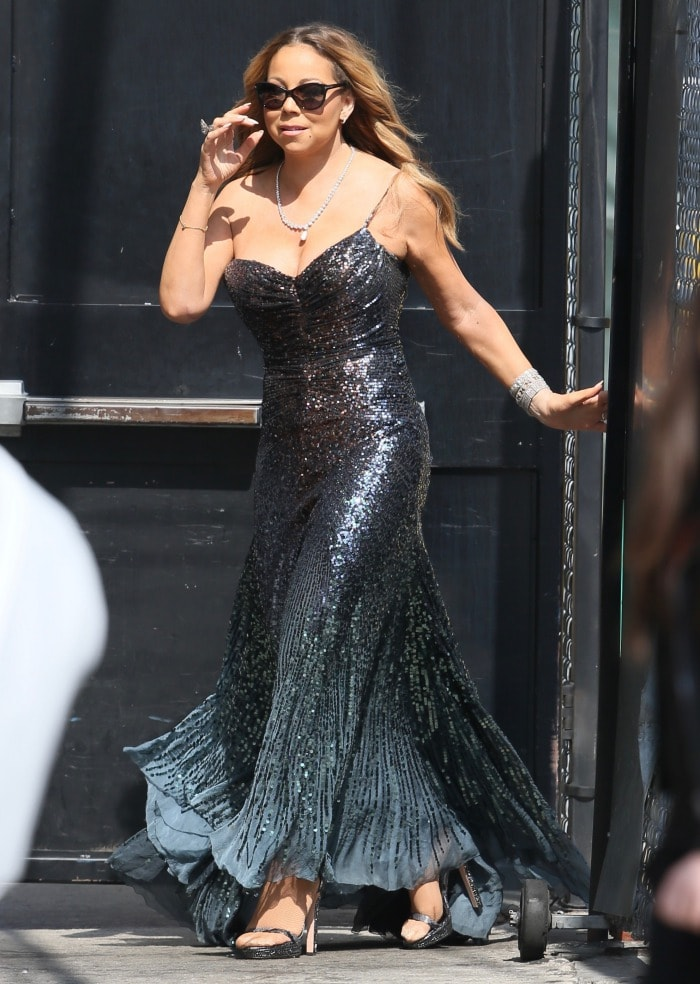 Mariah Carey in a figure-hugging gown covered in navy blue sequins