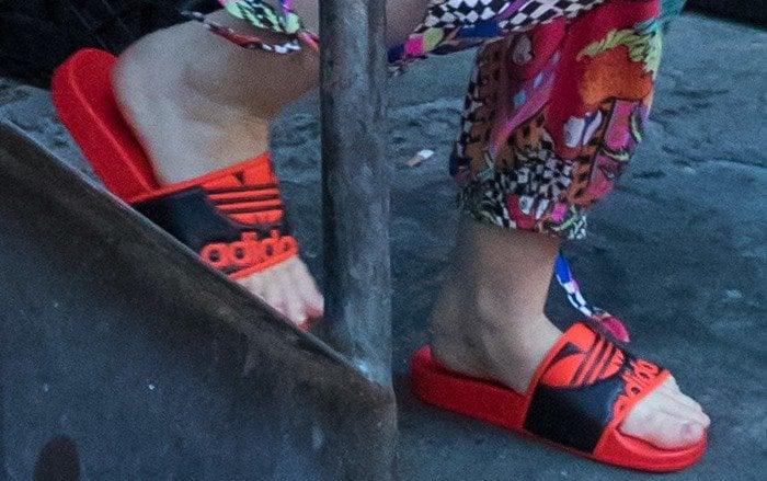 Miley Cyrus wearing red Adidas 'Adilette Trefoil' slides