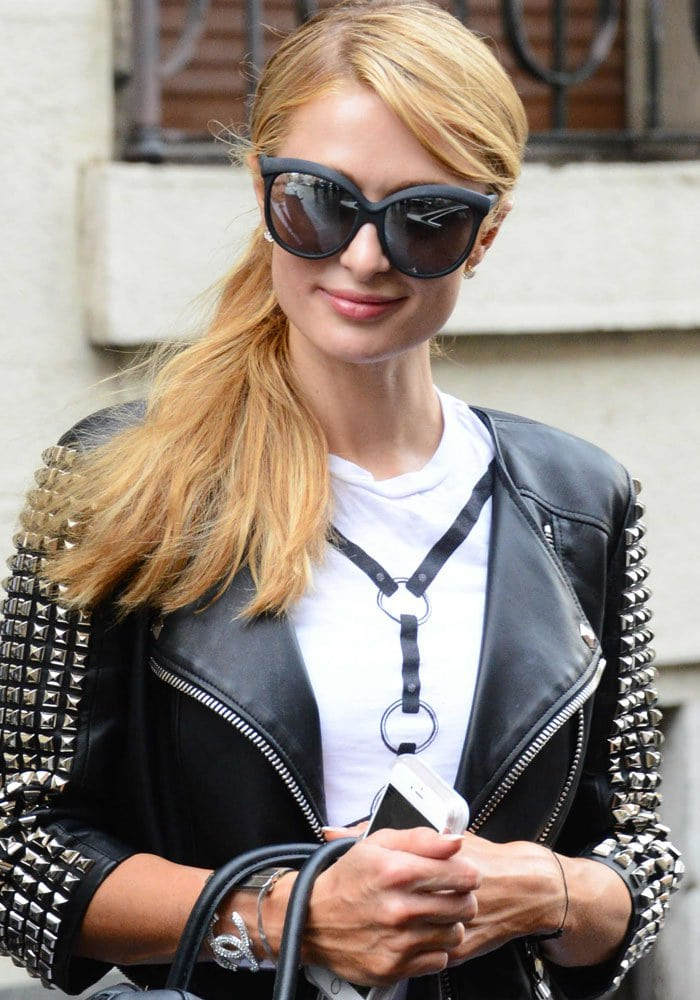"""Paris Hilton wearing Philipp Plein's leather """"Airglow"""" studded jacket while running errands in Milan, Italy on June 16, 2016"""