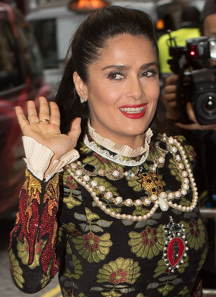 Salma Hayek with subtle smoky eyeshadow and a slick of bright red lipstick