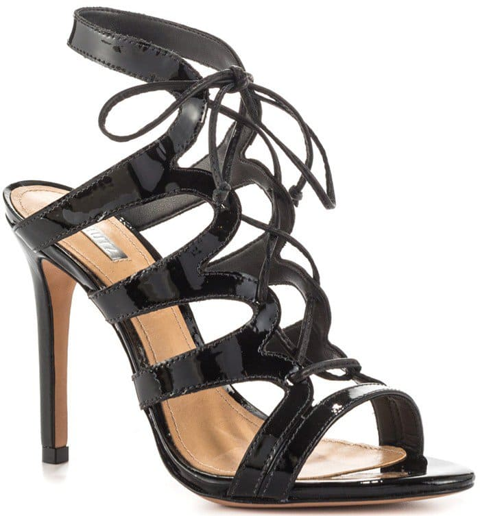 2719404ad9fb Scalloped straps lend a graphic touch to patent-leather Schutz sandals