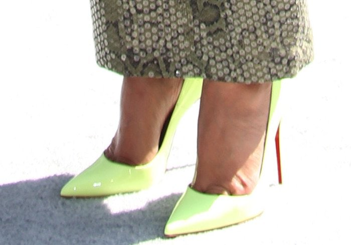 Tracee paired the dress with Christian Louboutin So Kate pumps in neon yellow