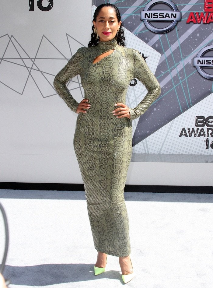 Tracee Ellis Ross wearing a dress featuring python printed stretch fabric covered in clear sequins