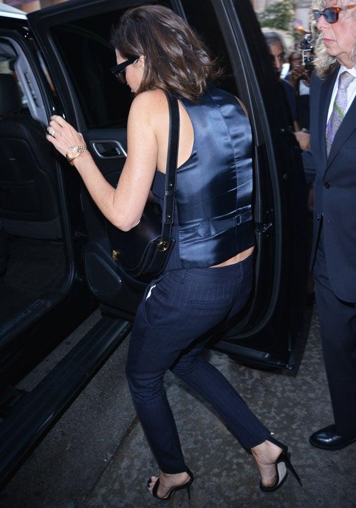 Victoria Beckham In Black Manolo Blahnik Chaos Sandals
