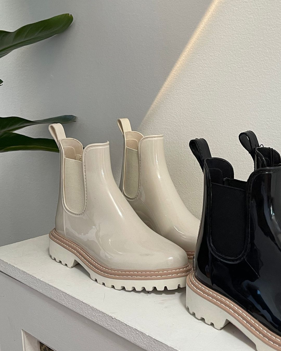 Wet conditions are no match for these black and ivory patent waterproof Chelsea boots with a sporty-looking rubber lug sole