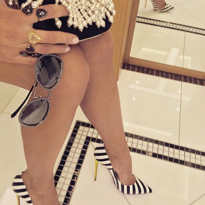 Blake Lively shared a bathroom shoefie of her Christian Louboutin So Kate striped pumps at the photo call for