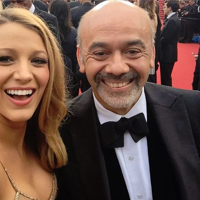 Blake Lively posted a photo with her date, footwear designer Christian Louboutin, and then posted a selfie with him at the Cannes premiere of Cafe Society on May 11, 2016