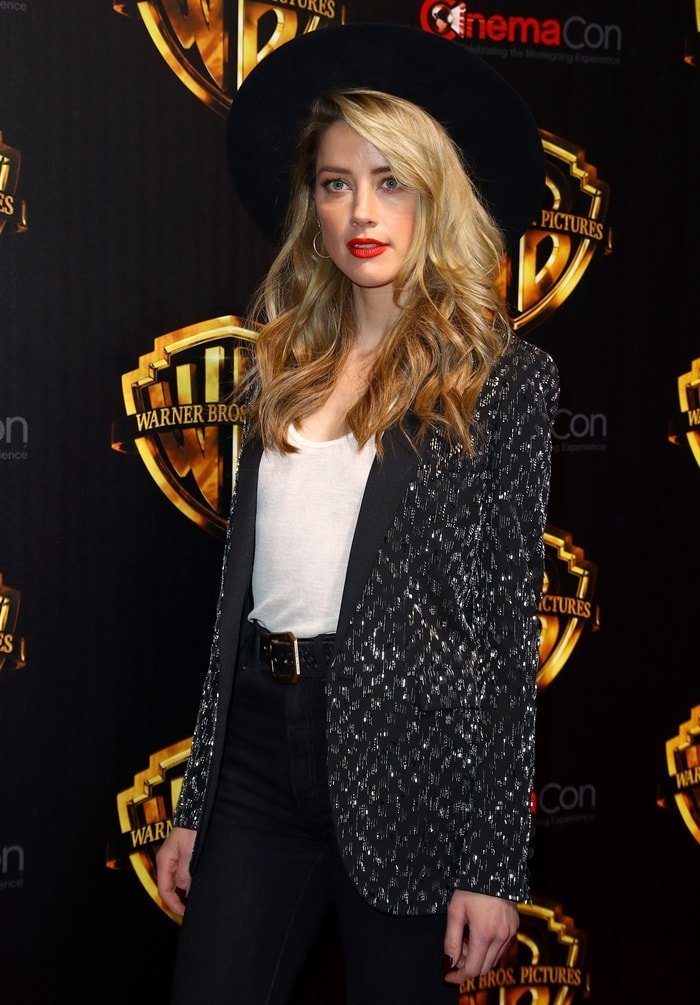 Amber Heard wearing a statement hat to promote her new movie 'Aquaman'