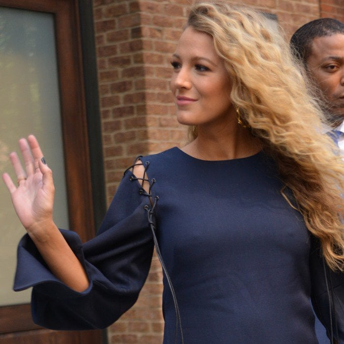Pregnant Blake Lively shows off her baby bump in a Monse long-sleeve mini dress