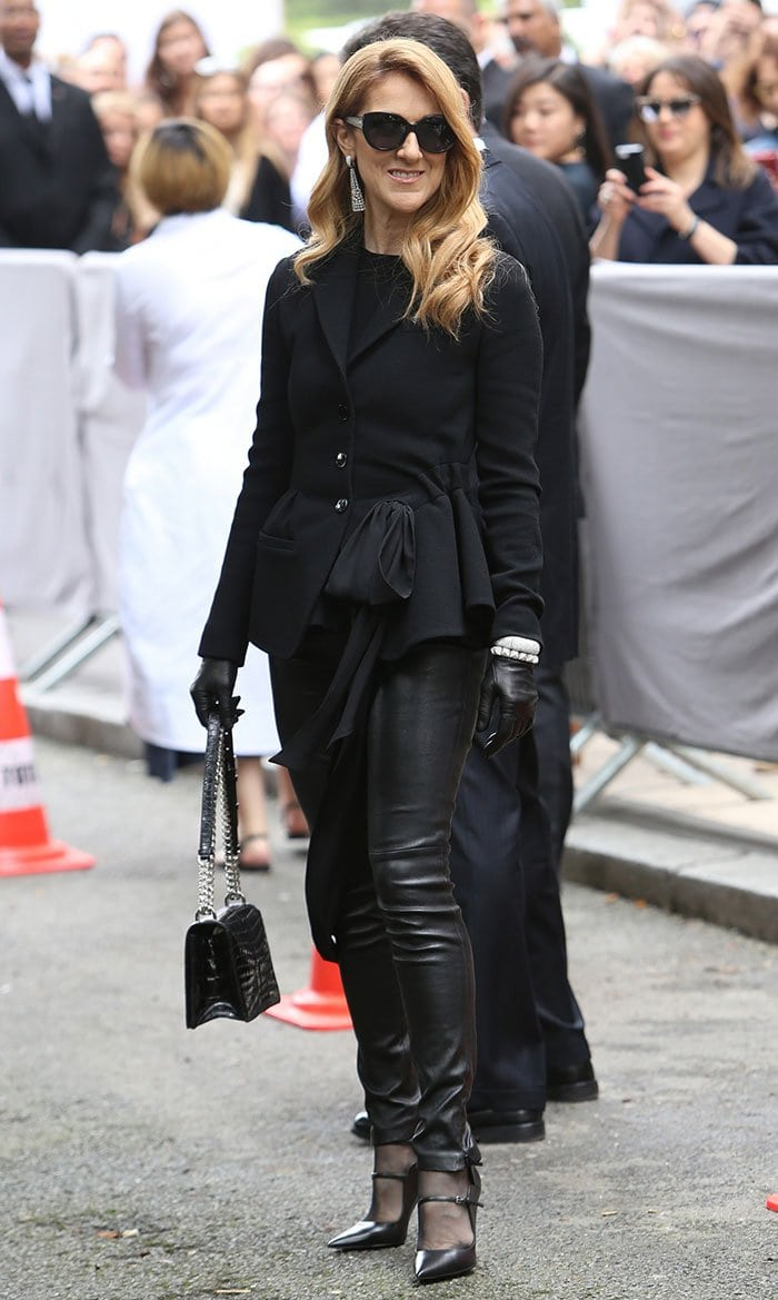 Celine Dion in chic leather pants paired with a bow-detailed jacket