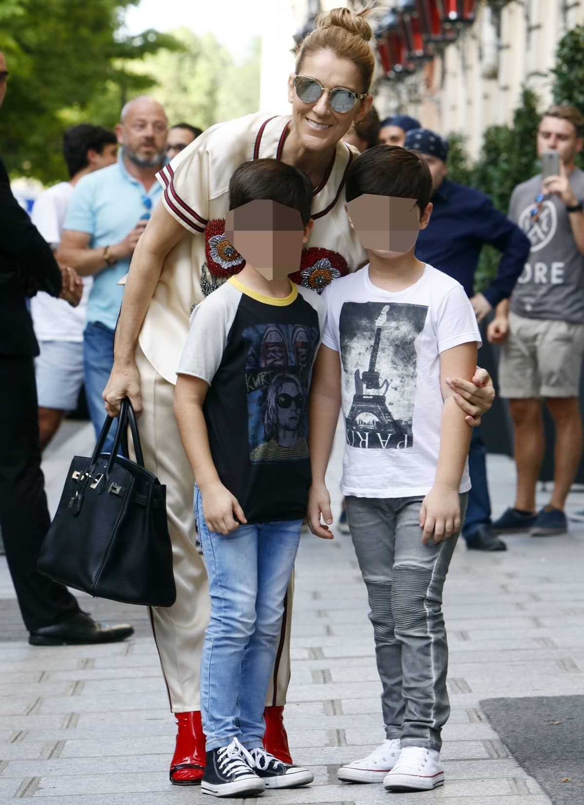 Celine Dion with her twin sons Eddy and Nelson Angélil in Paris