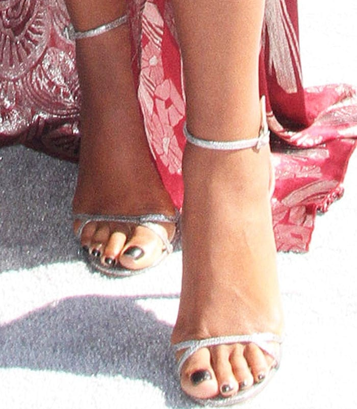 Gabrielle Union shows off her feet in silver glitter Jimmy Choo sandals