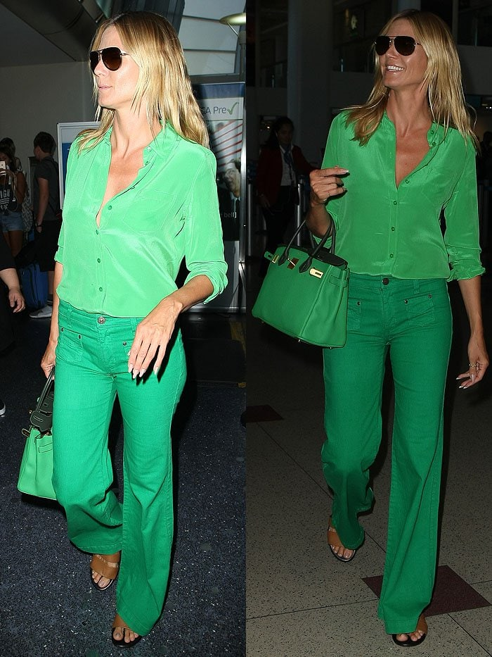 Heidi Klum wearing an all-green outfit at the Los Angeles International Airport (LAX)