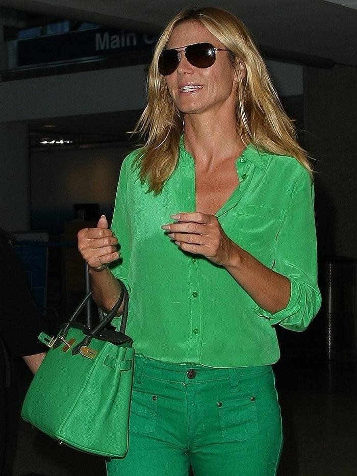 Heidi Klum toted a green Hermes Birkin bag