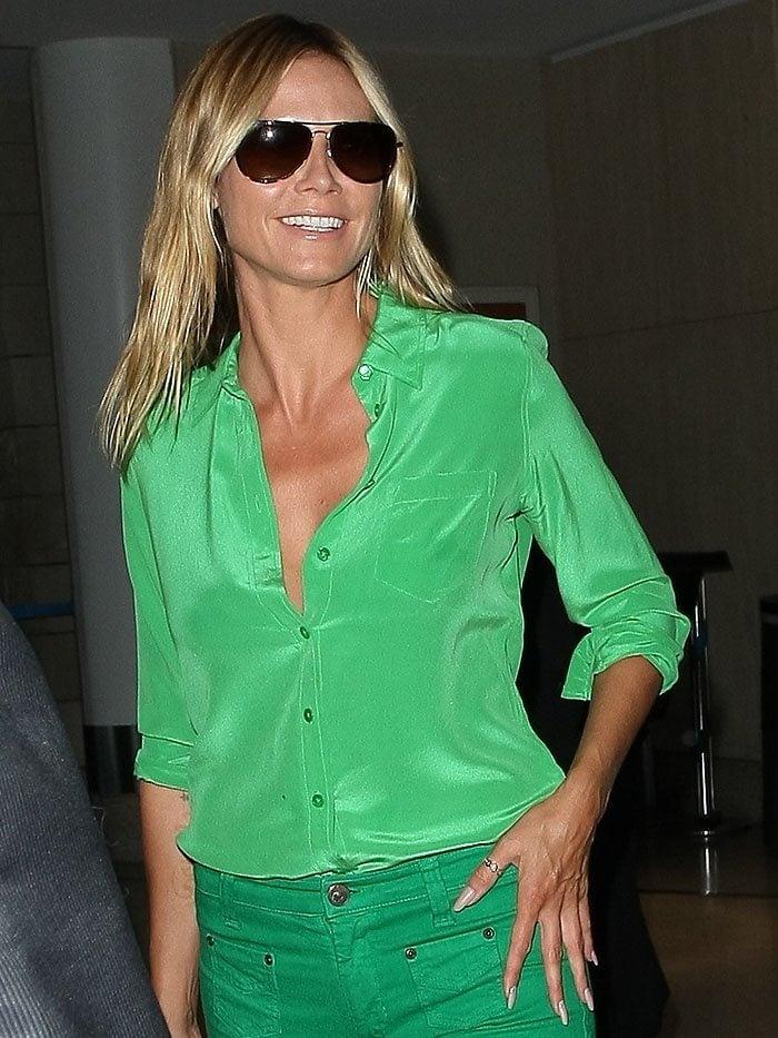 Heidi Klum rocked a green Equipment shirt with a fold-over collar and an 8-button closure