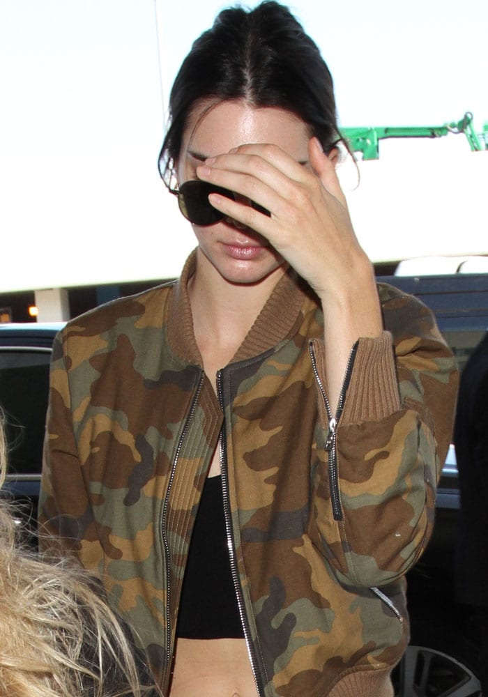 Kendall Jenner in a camouflage bomber jacket over a black crop top