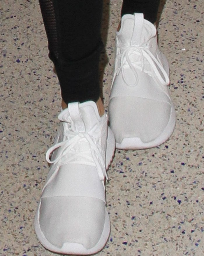 Kendall Jenner's Adidas Tubular Defiant sneakers in white